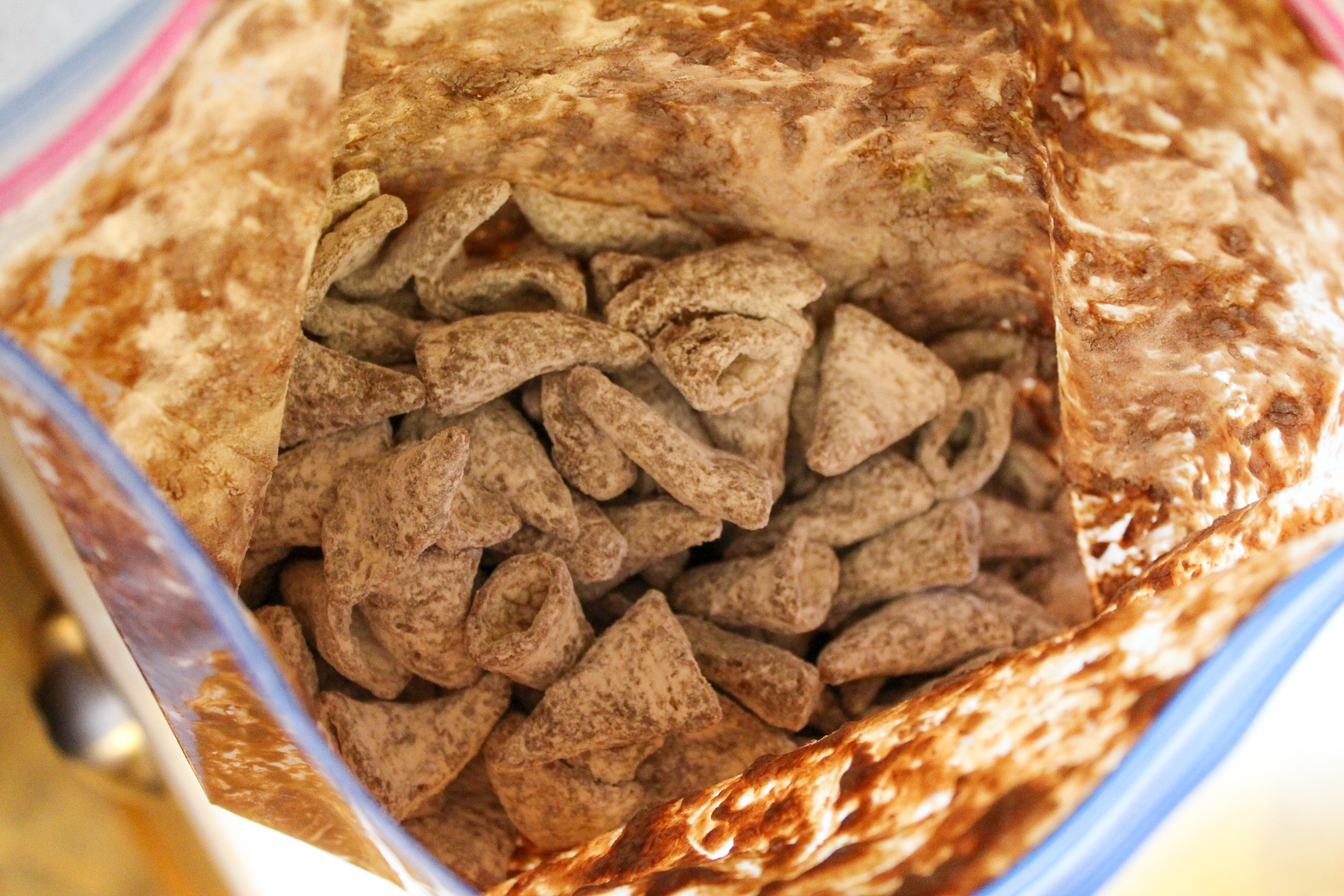 bugles with chocolate and powdered sugar in a bag
