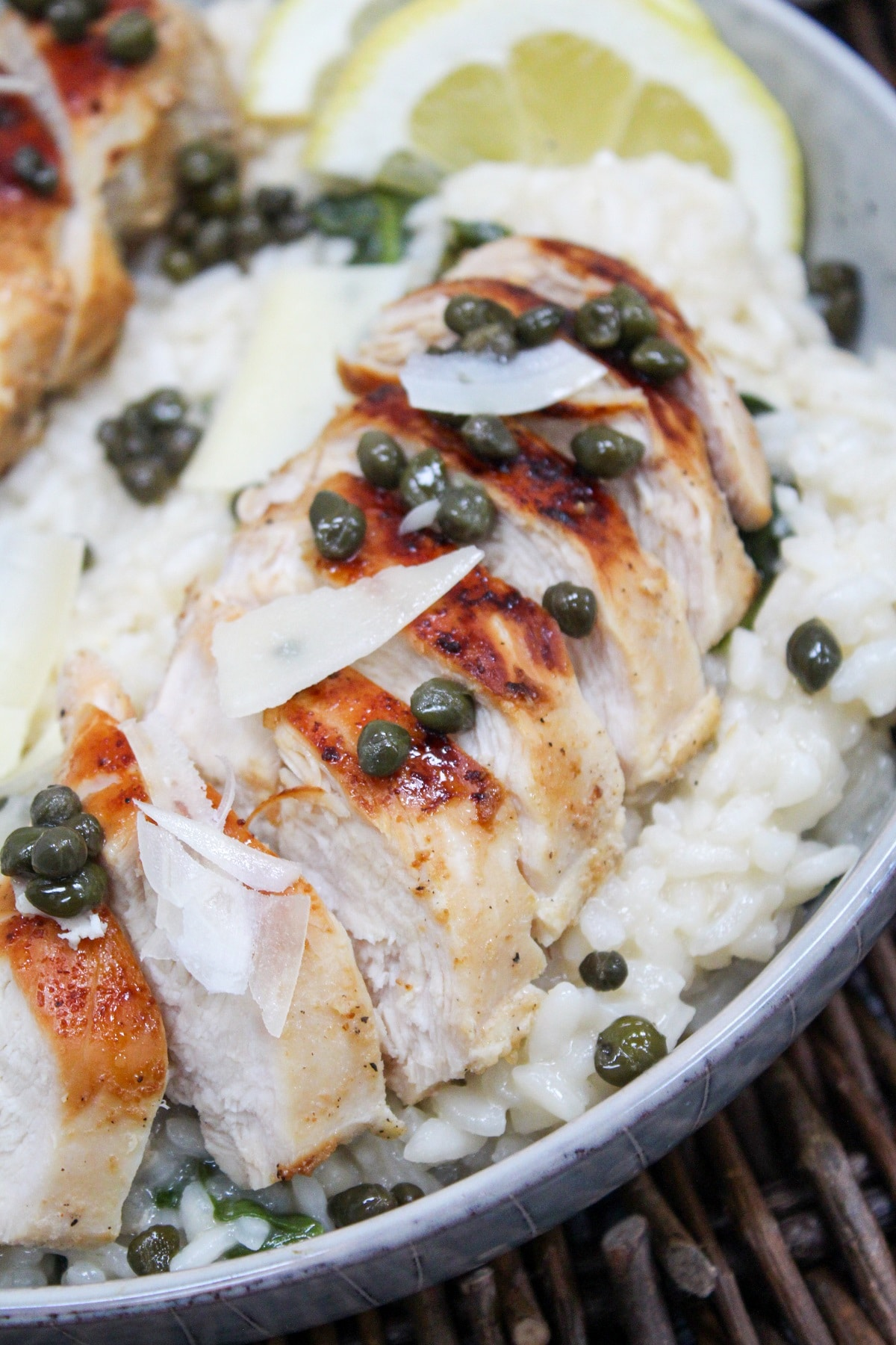sliced chicken over risotto