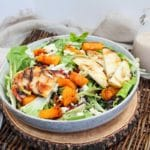 salad in a bowl with grilled apples and pears
