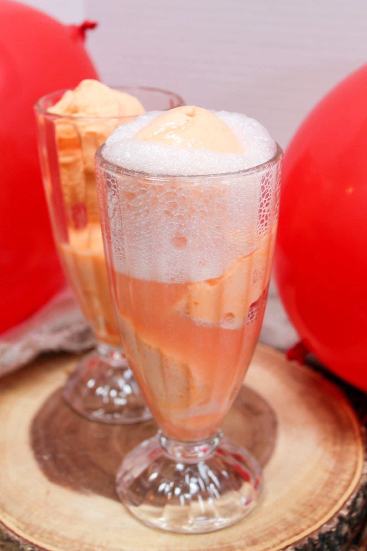 ice cream float in a glass with cherry soda