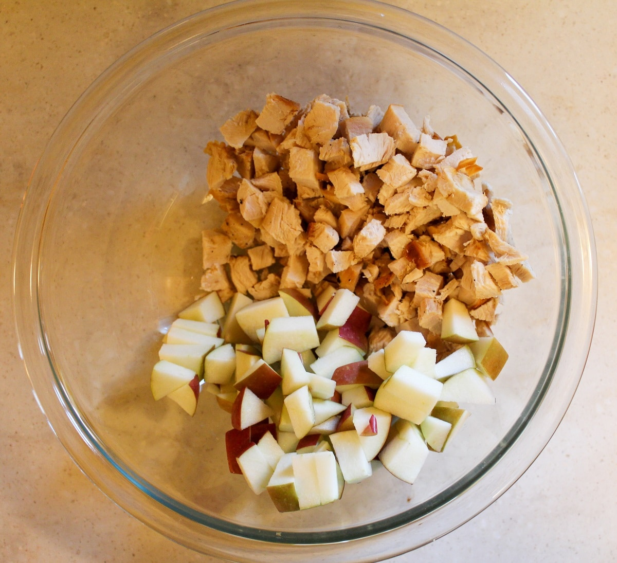 chopped turkey and apple in a bowl