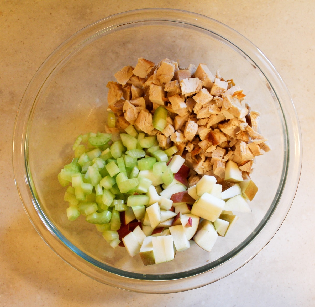 chopped turkey, celery, and apple in a bowl