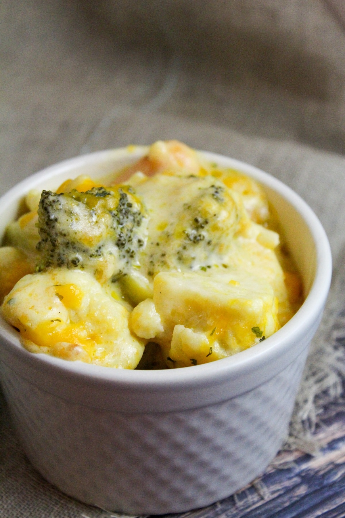 cheesy vegetables in a small bowl