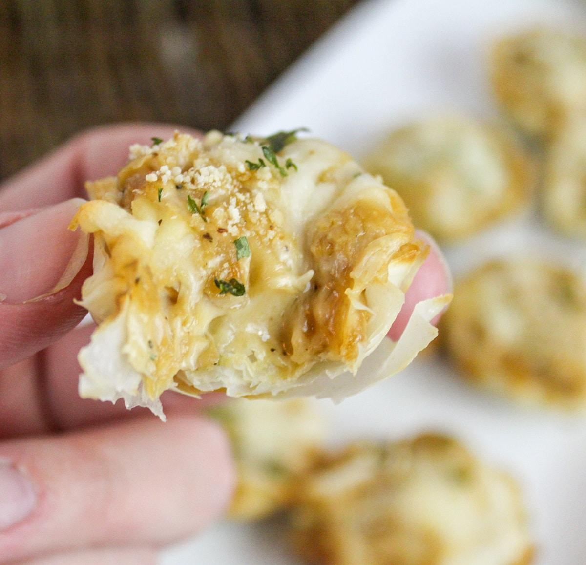 french onion tartlete with bite taken