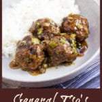 cooked meatballs in dish with rice