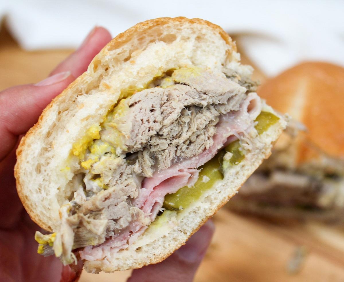cuban sandwich held in hand