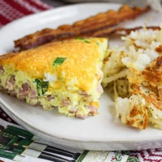 denver omelette on a plate with hashbrowns