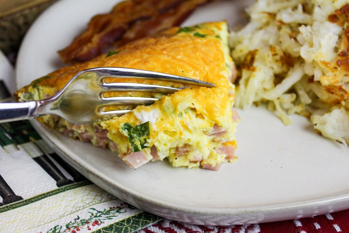 omelette on a plate and cut with a fork