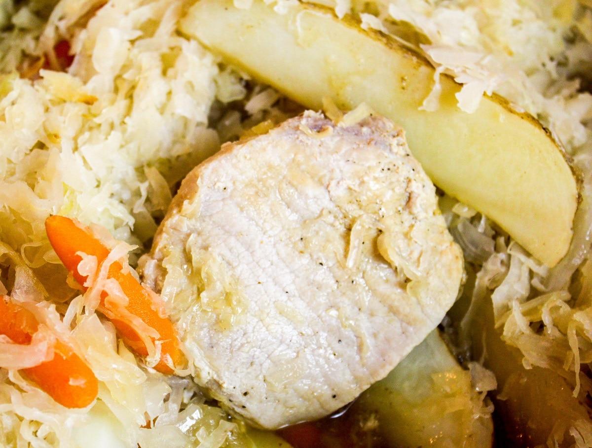 close up photo of pork chop in the pot
