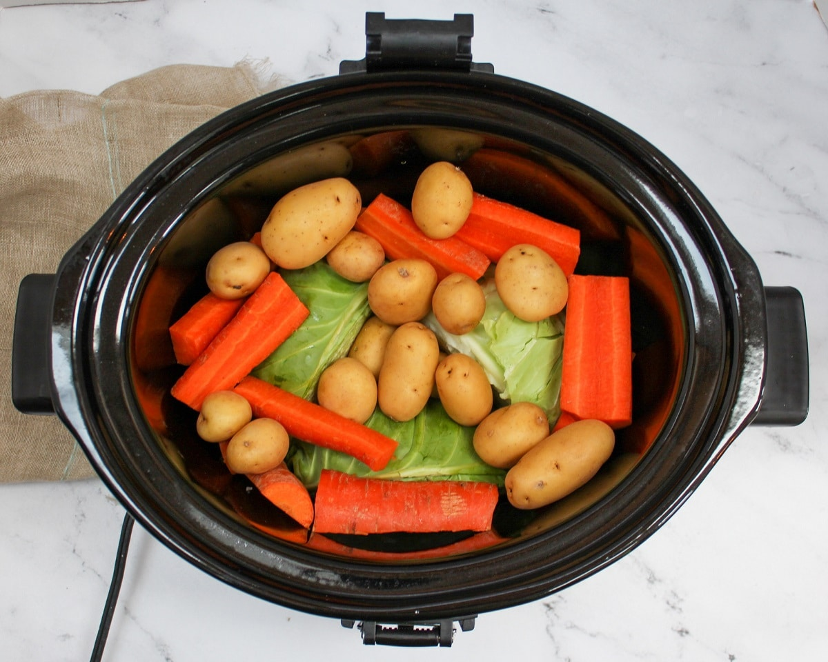 uncooked carrots, potatoes, and cabbage