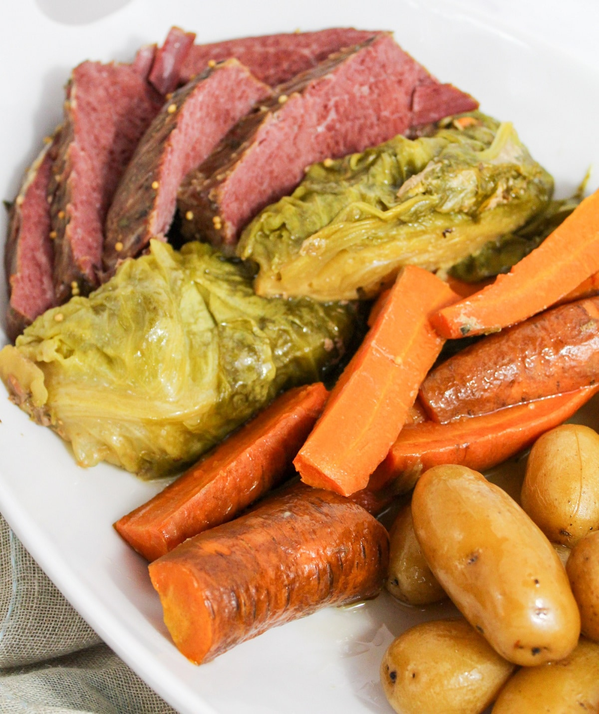 plated corned beef, cabbage, carrots, and potatoes