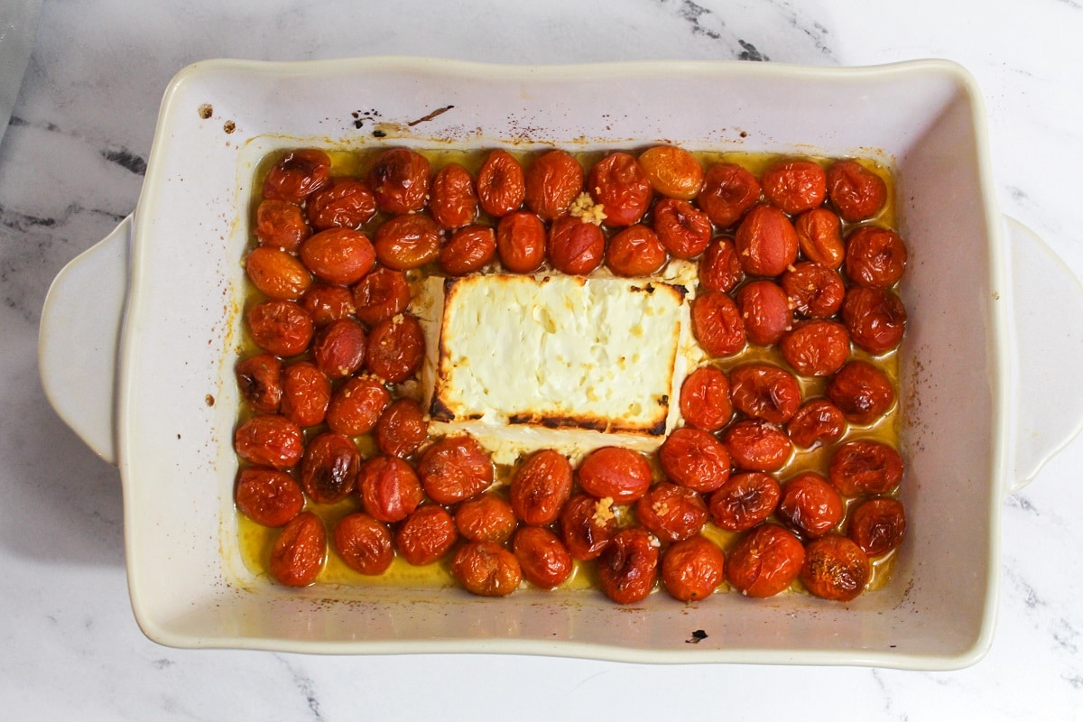 cooked tomatoes and feta