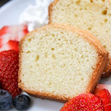mini pound cake sliced with berries on a plate