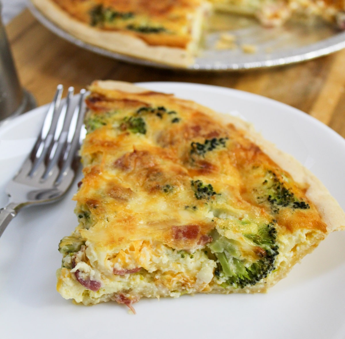 bacon broccoli quiche plated with fork