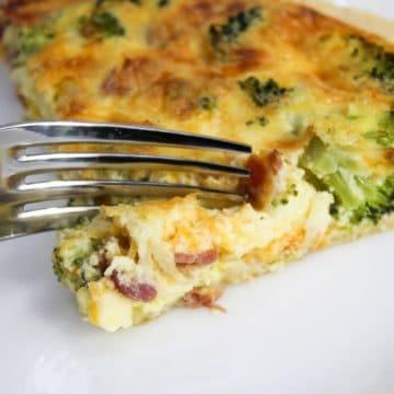 bacon broccoli quiche cut with a fork