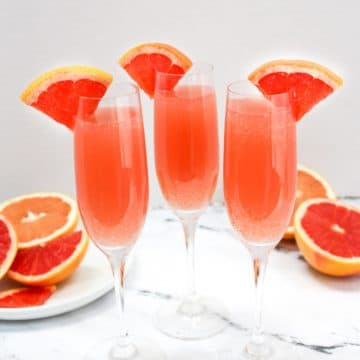 rose mimosas garnished with grapefruit slices