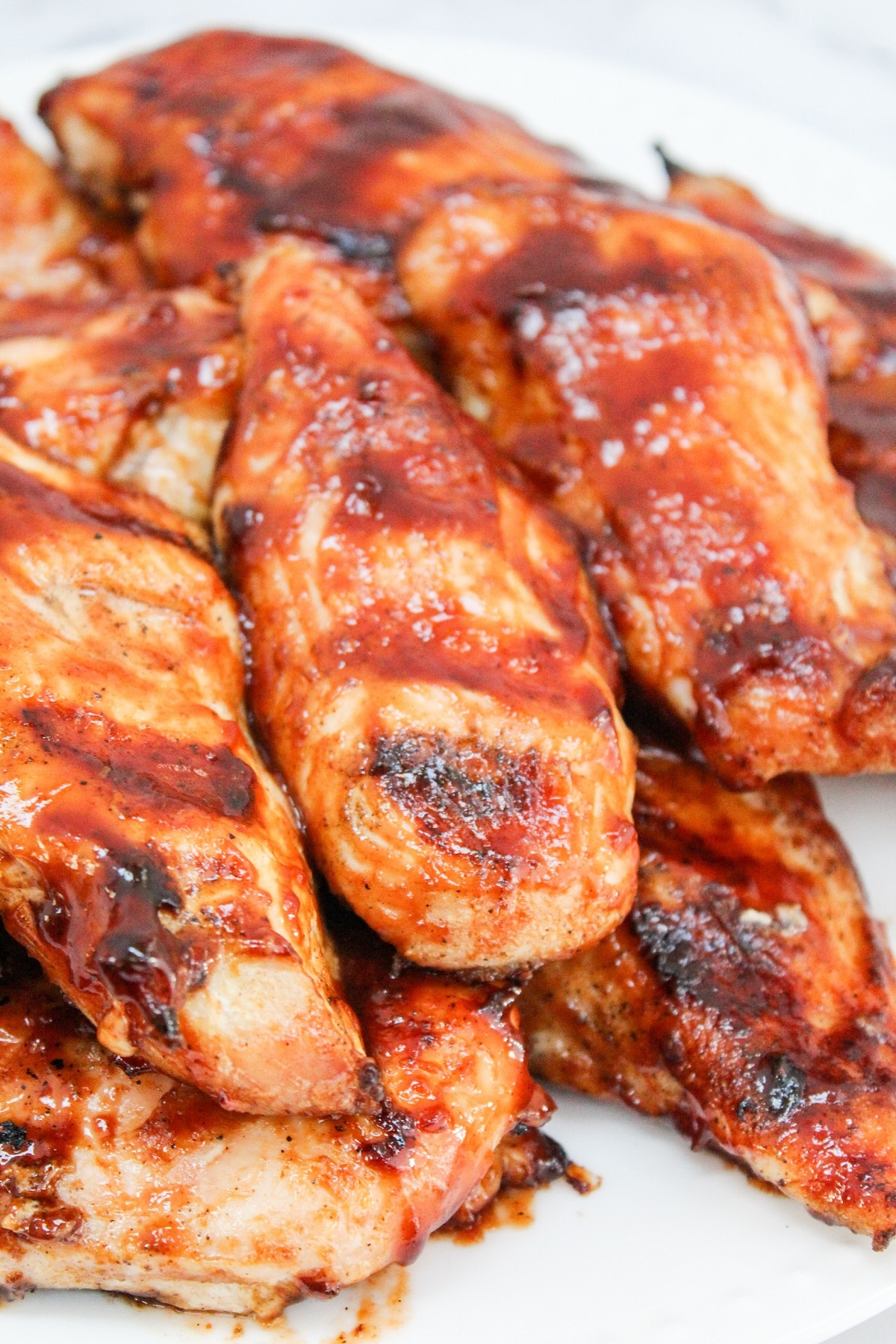 grilled bbq chicken on a white plate