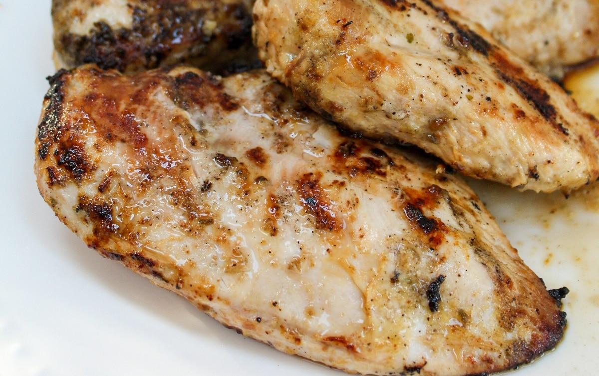 grilled lemon pepper chicken on white plate