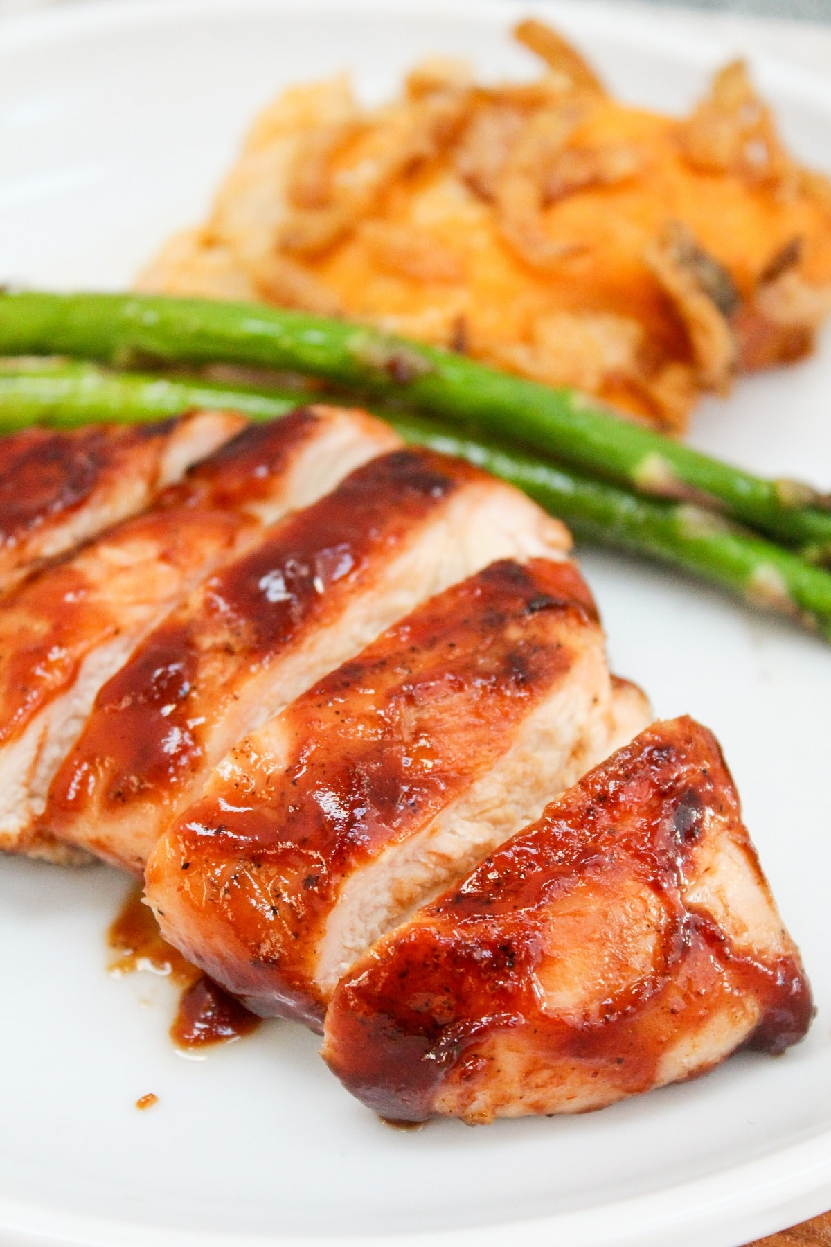 bbq chicken on a plate with asparagus
