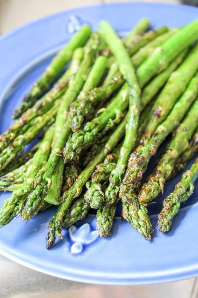 asparagus on a blue plate