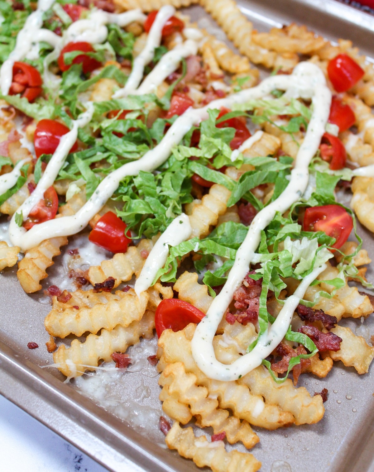 completed blt fries on tray