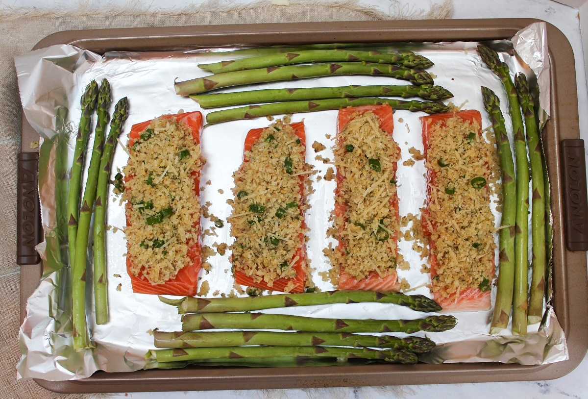 salmon with topping and asparagus