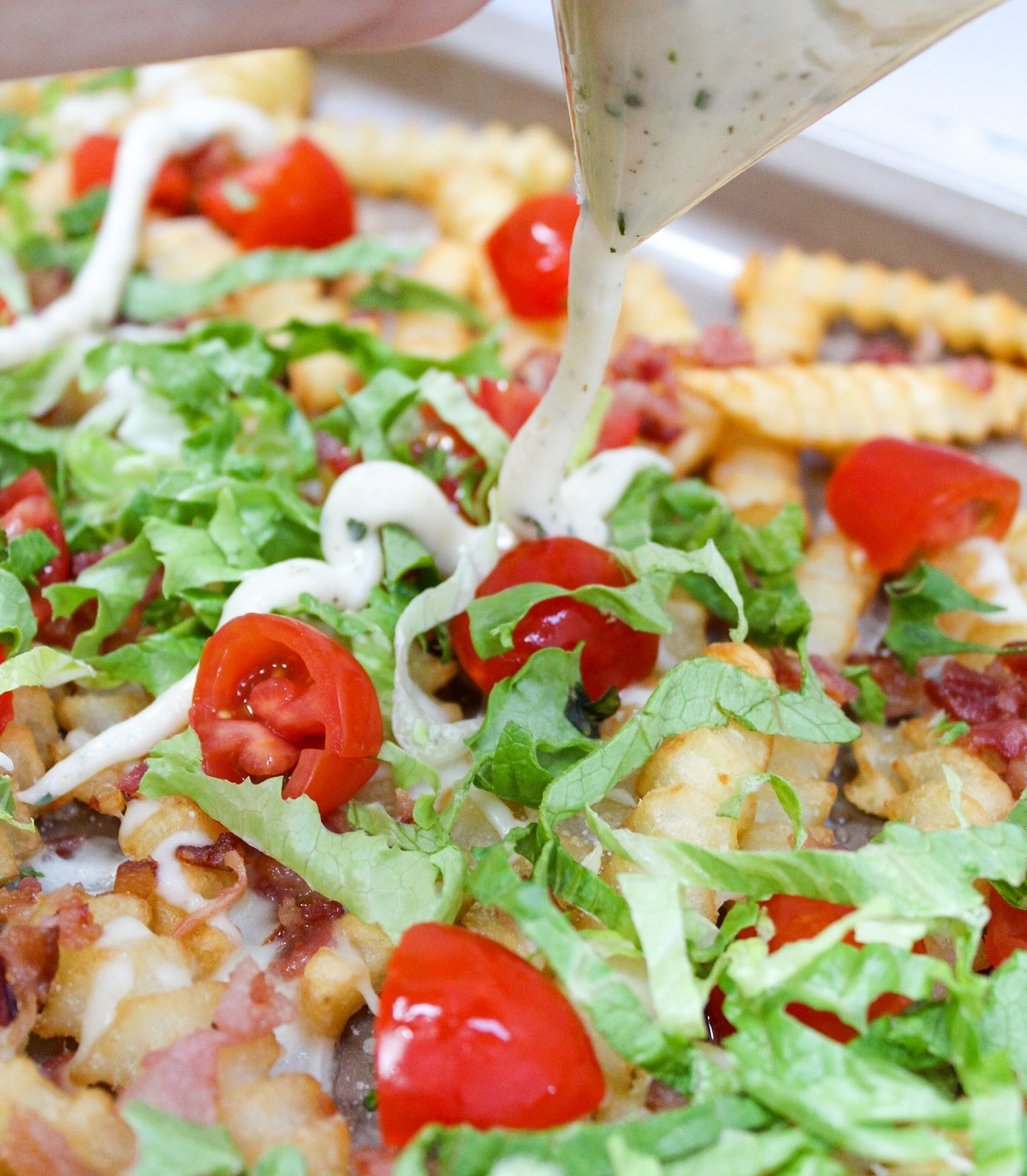 loaded blt fries with sauce poured on top
