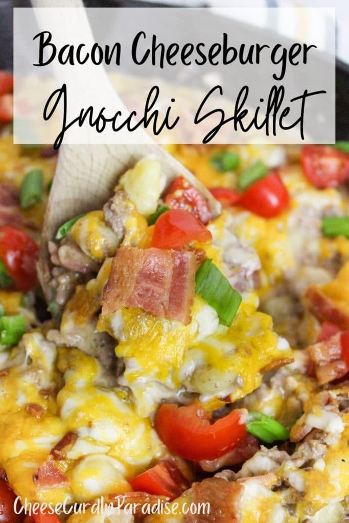Bacon Cheeseburger Gnocchi Skillet in cast iron skillet scooped with a spoon