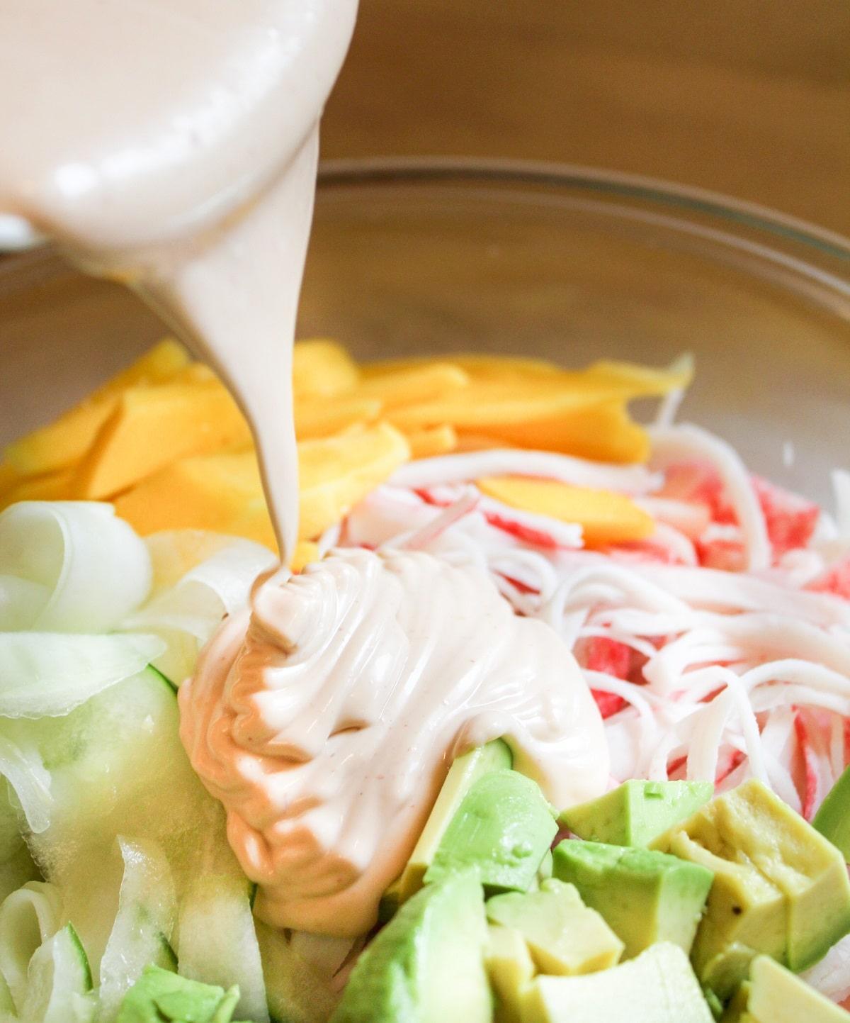 dressig poured over the kani salad
