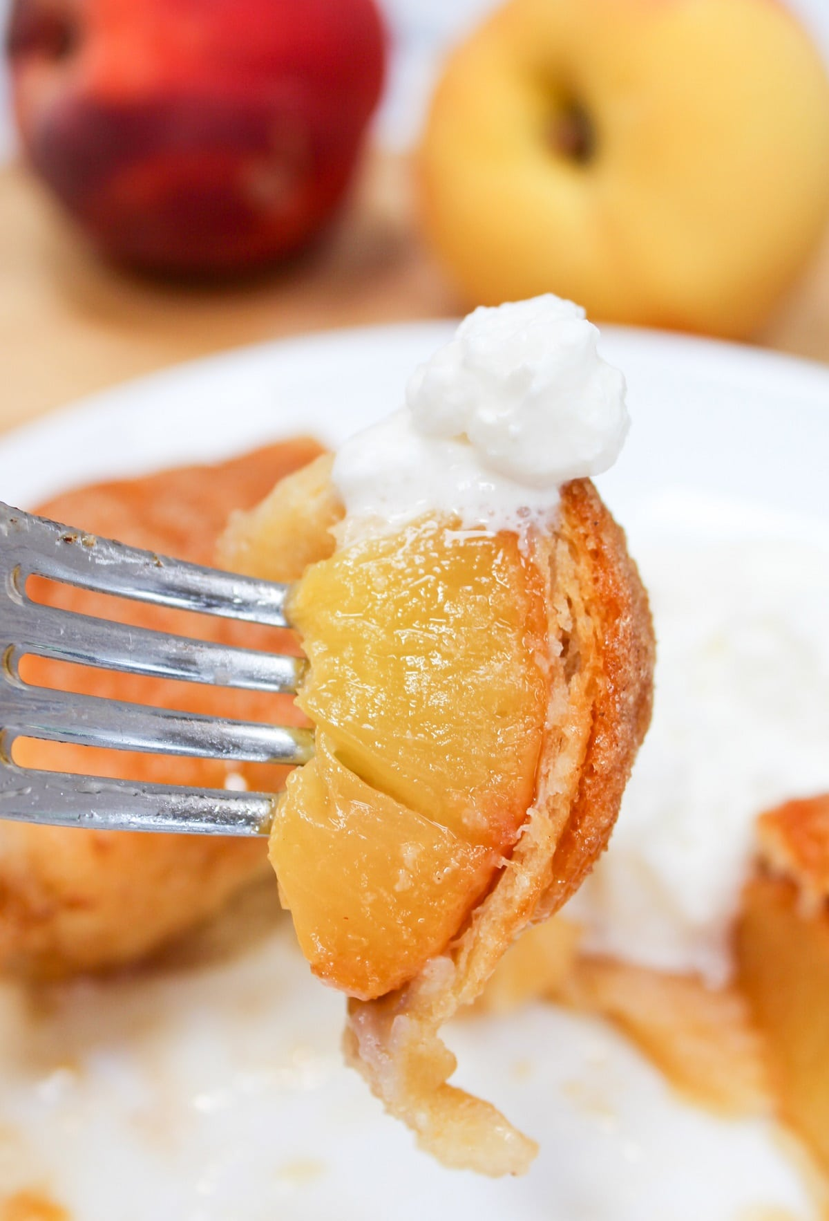 dumpling on a fork with whipped cream on top