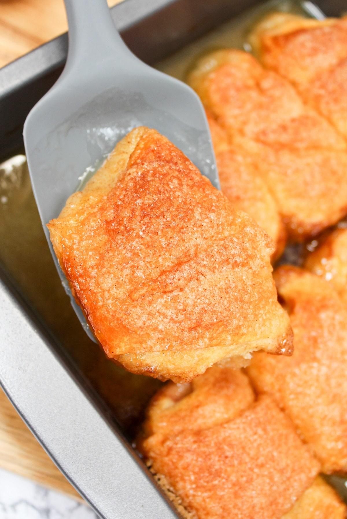 baked peach dumplings scooped from pan