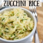 cooked cheesy zucchini rice in a bowl with a fork on the side