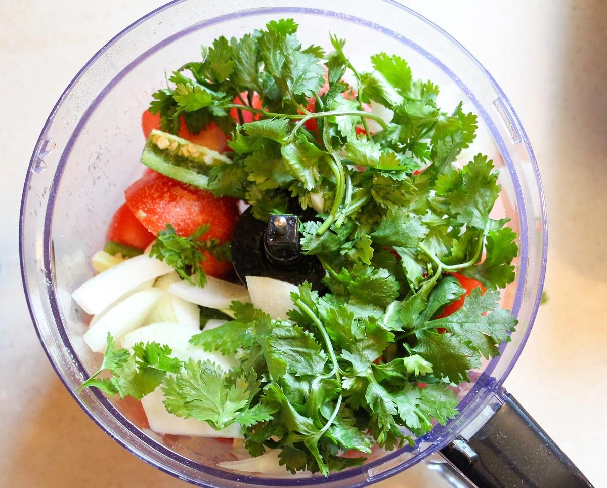 tomatoes, pepper, onions, cilantro in a food processor