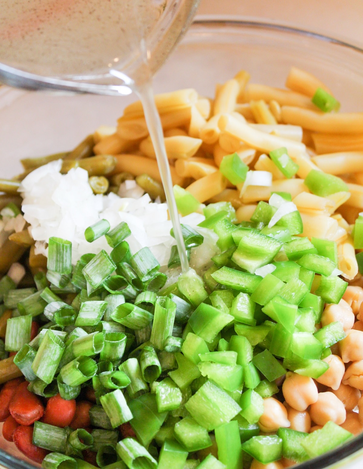 dressing poured over 3-bean salad