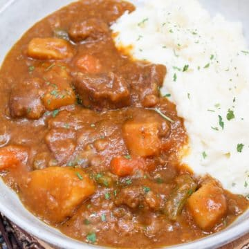 pumpkin beef stew in a gray bowl