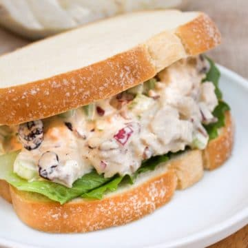 Cranberry Pecan Chicken on white bread on a plate