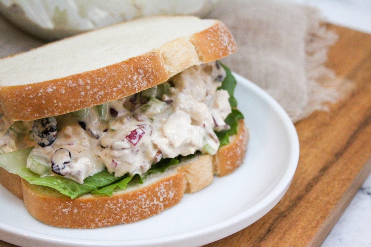 Cranberry Pecan Chicken on white bread on plate