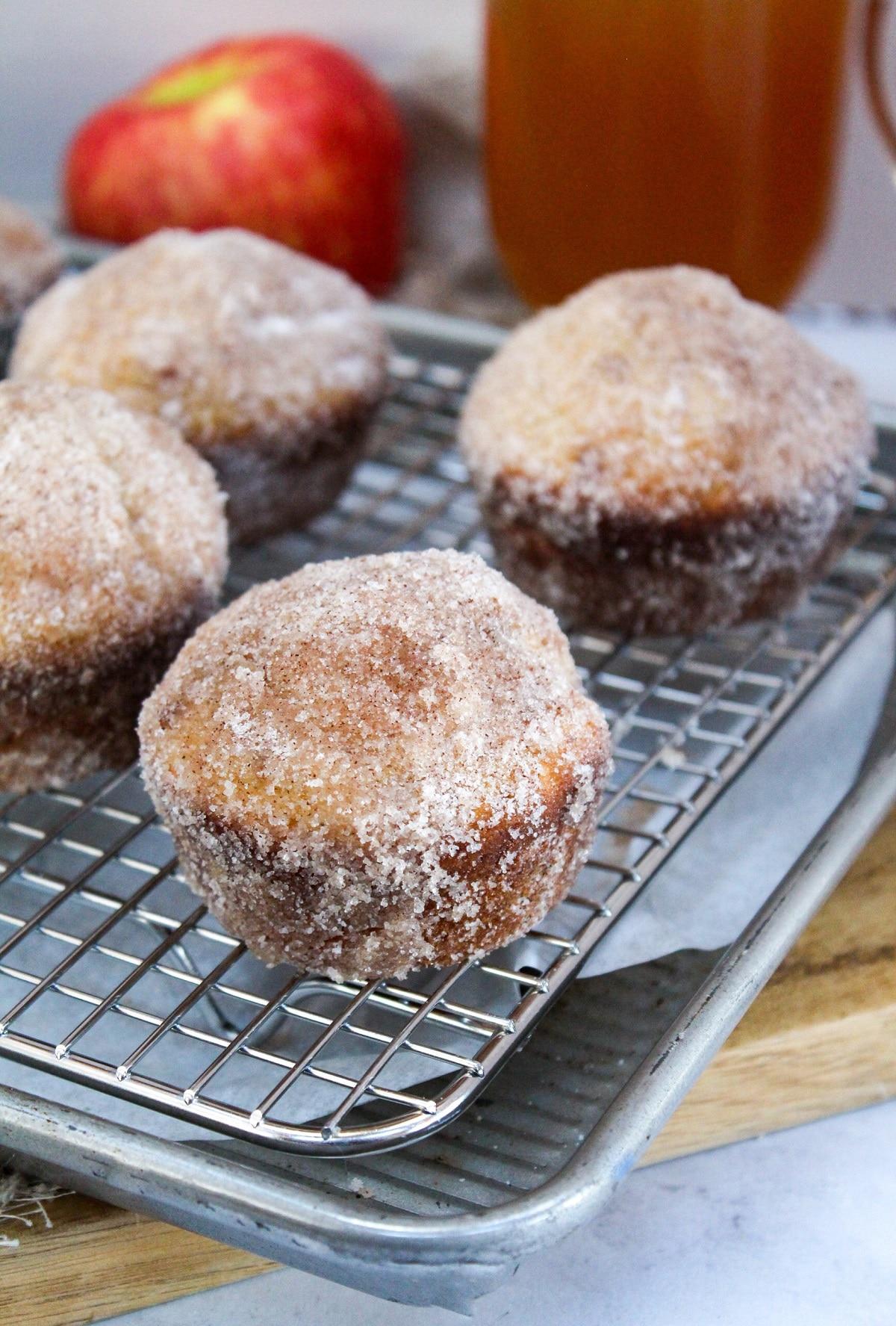 apple cider donut muffins on cooling rack