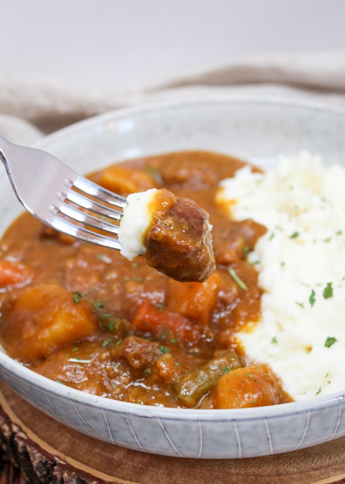 pumpkin beef stew on a fork