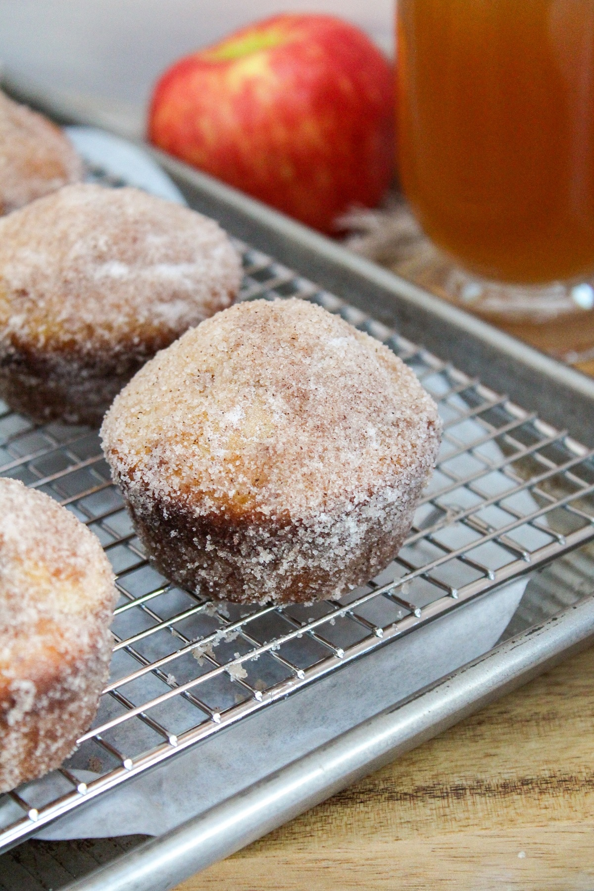 apple cider doughnuts muffins on cooling rack
